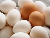A lots of white and brown chicken eggs close-up